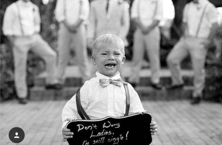 crying boy with sign don't worry ladies, I'm still single