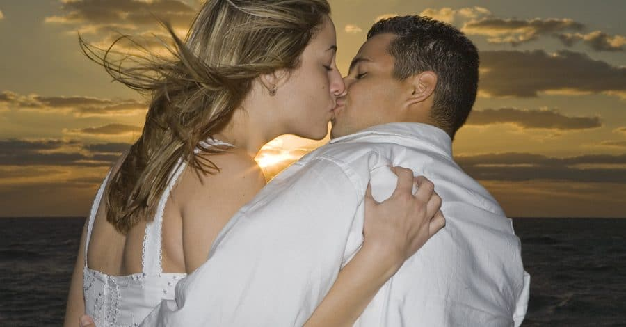 Lori Barbely Photography - couple kissing on beach at sunset