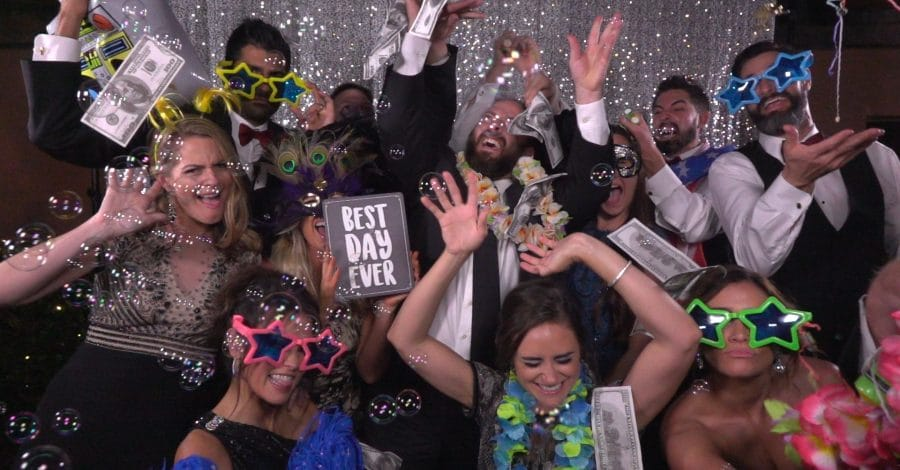 Omarvelous Productions - guests celebrating in photo booth with bubbles