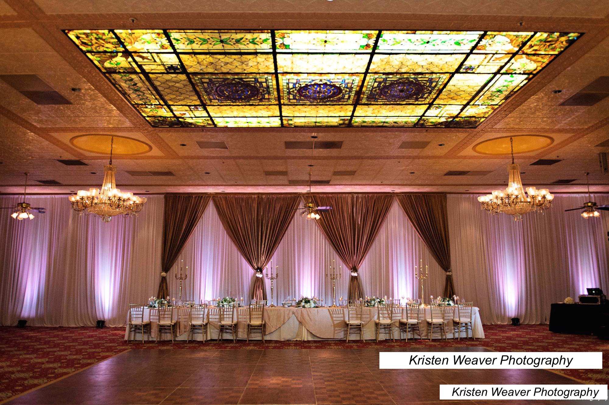 purple uplighting in reception hall with stained glass ceiling