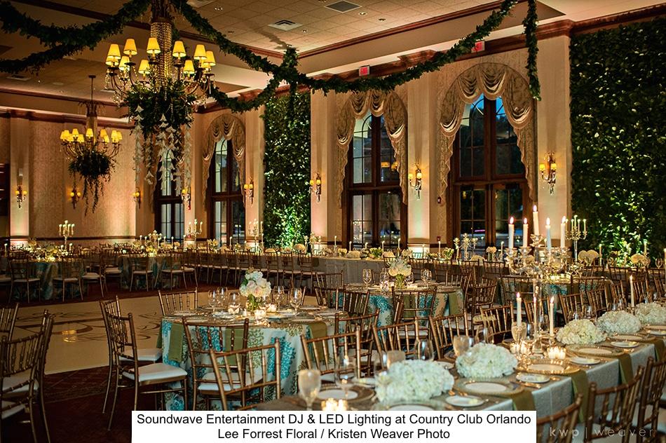 warm uplighting in stunning garden themed reception hall