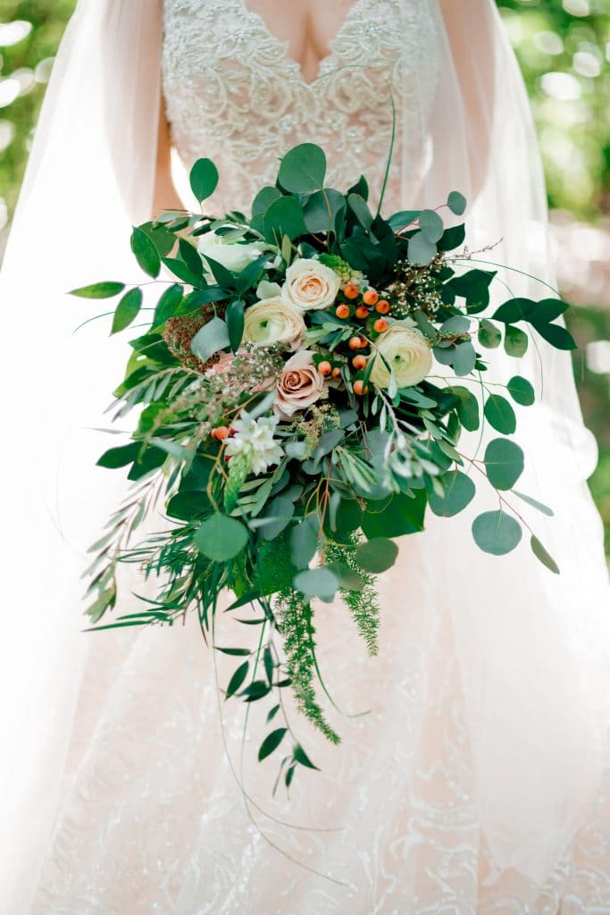 closeup of bouquet with lots of loose greenery