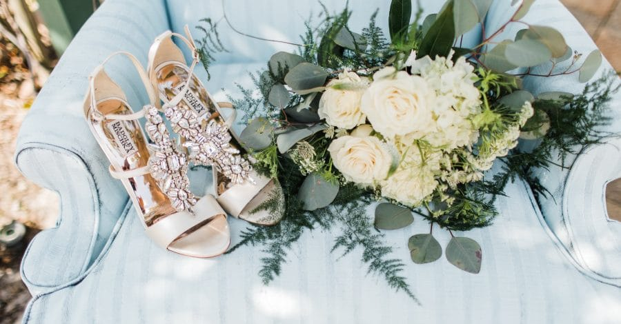 The Flower Studio - bouquet and shoes sitting on outdoor upholstered chair