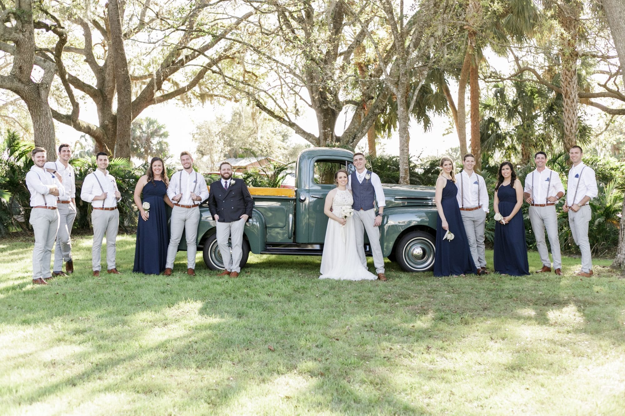 wedding party in front of vintage pickup truck