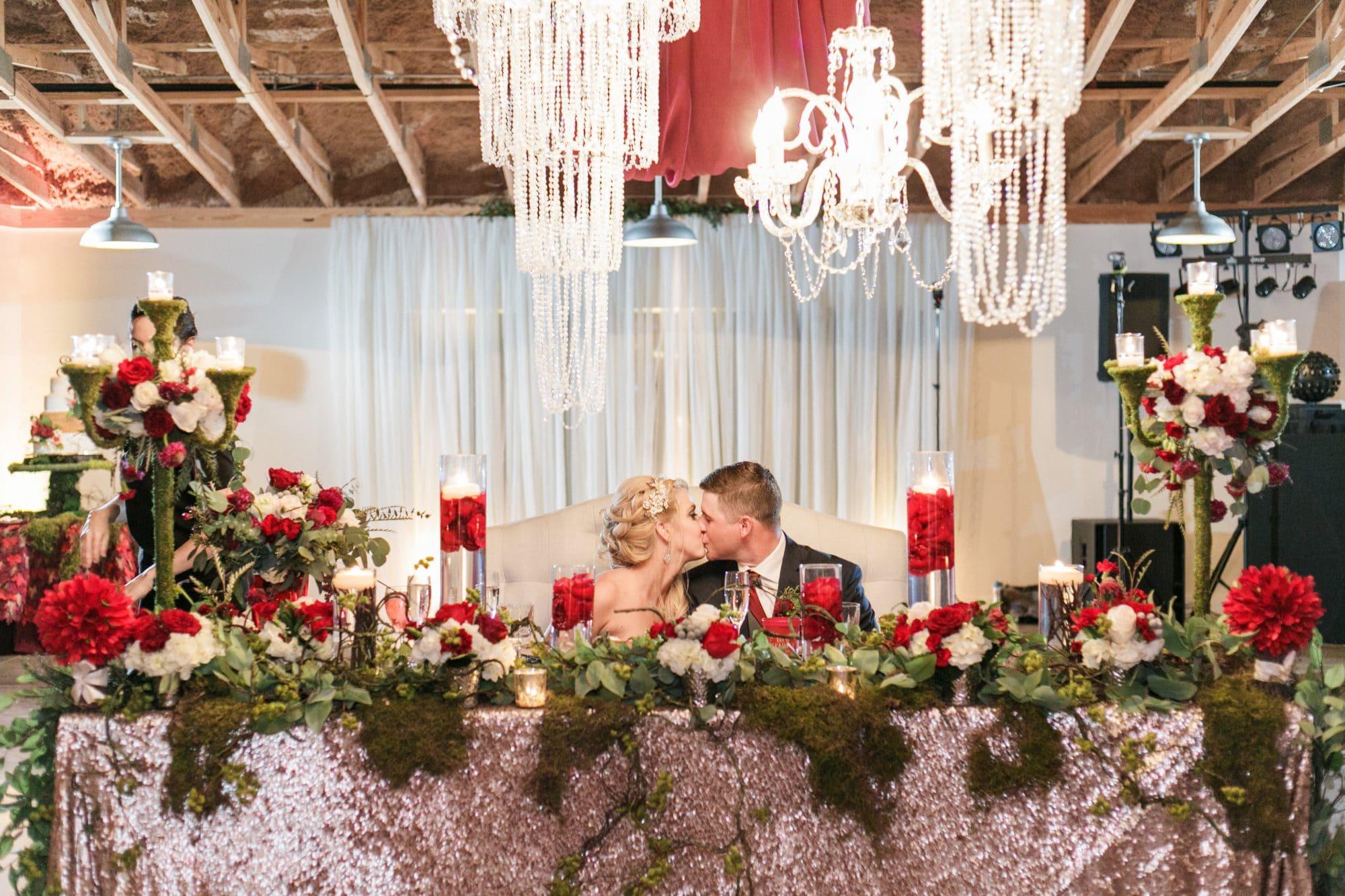 glamorous sweetheart table in rustic barn setting