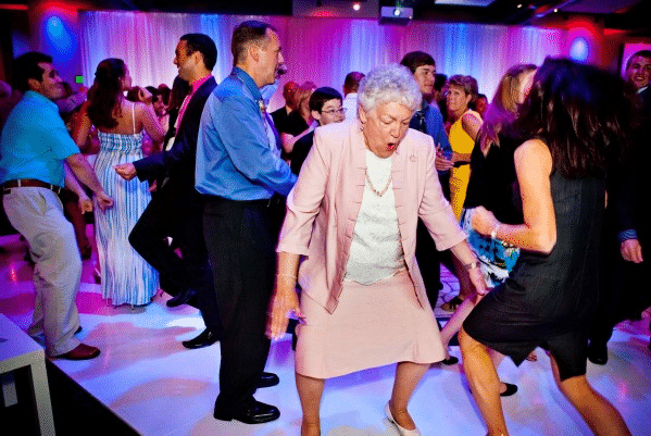 grandma and other guests dancing at wedding