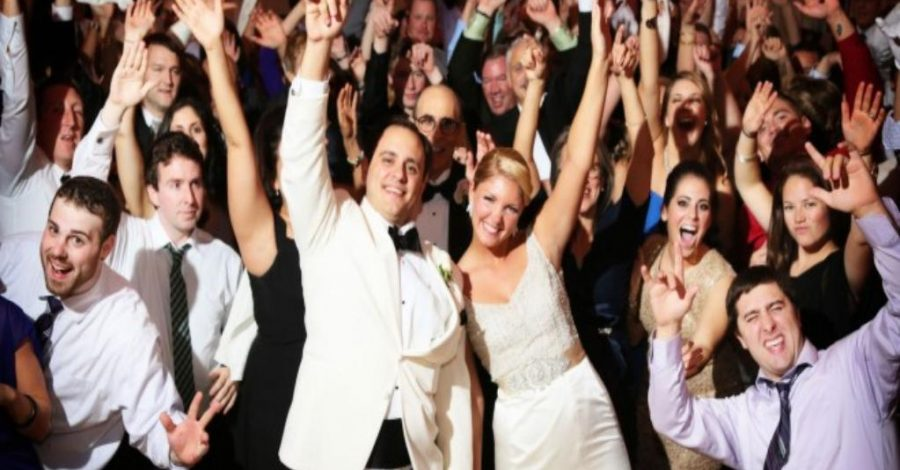 happy guests with hands raised
