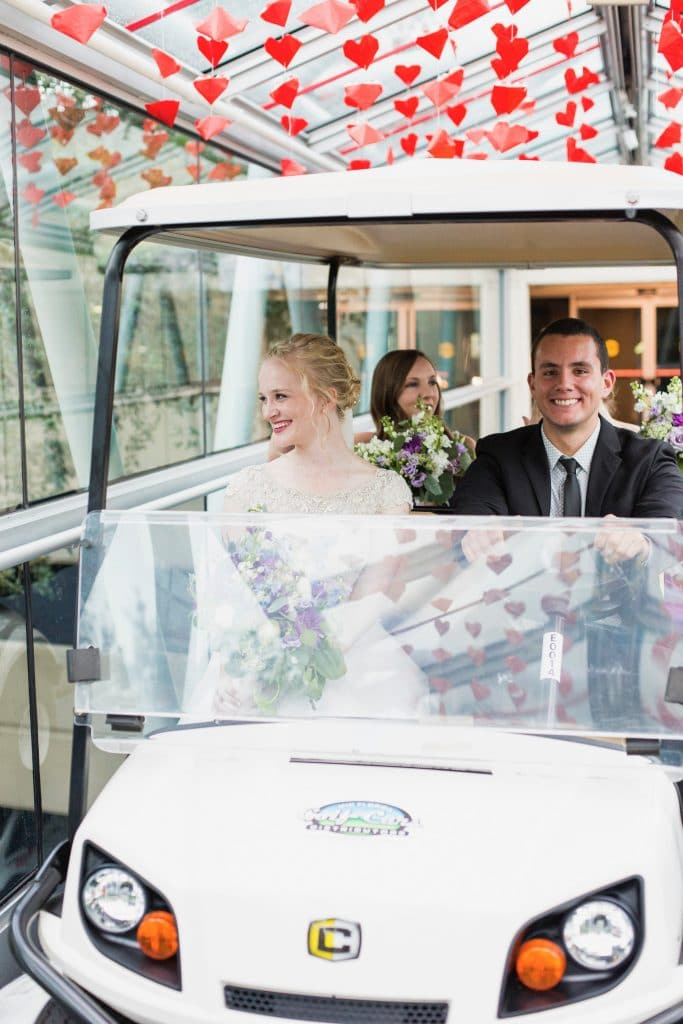 Wedding party in golf cart in Orlando Science Center walkway