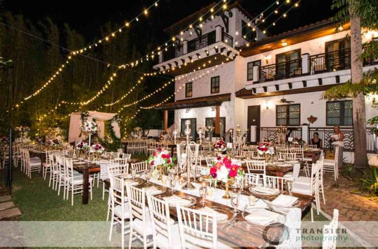 White chiavari chairs at outdoor reception