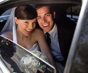Transportation & Limos - bride and groom smiling in limo backseat
