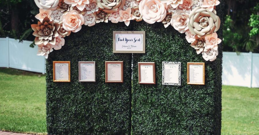 Dazzling Deco - seating chart wall with vines and oversized flowers