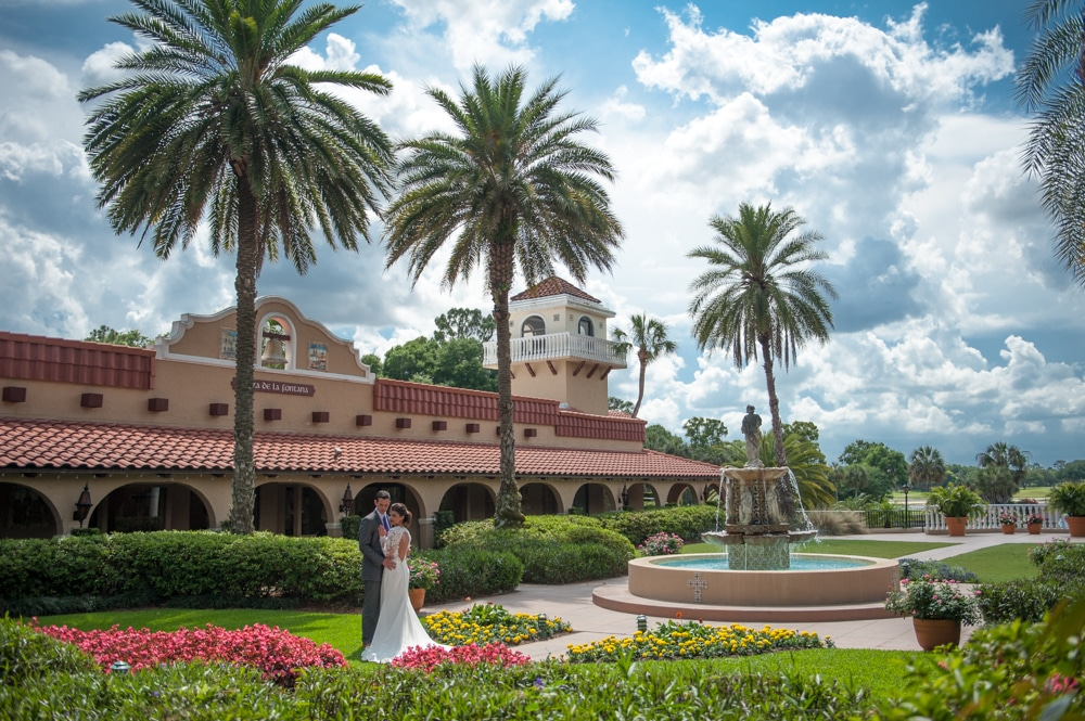 Bride and groom posing in courtyard at Mission Inn Resort