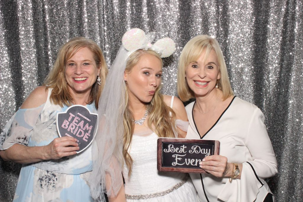 Party Shots Orlando - bride in photo booth with Minnie Mouse wedding ears