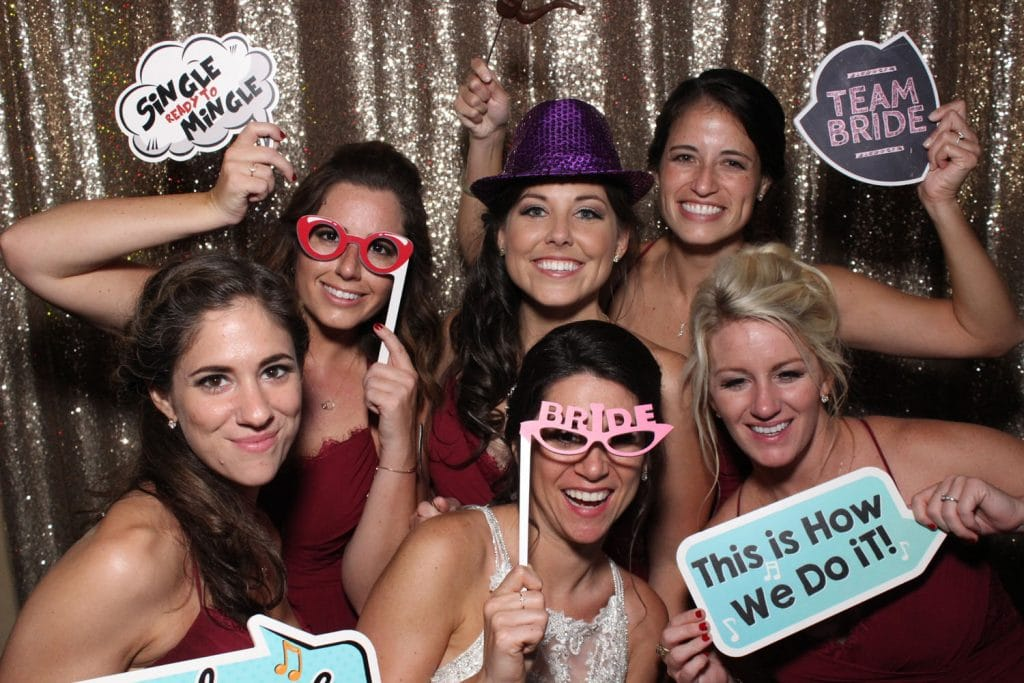 Party Shots Orlando - bridal party with signs in photo booth