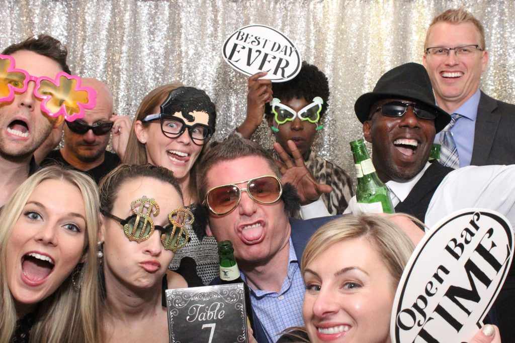 Party Shots Orlando - large group in photo booth with funny props