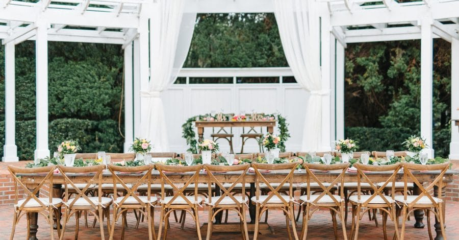 Plan It Events - large rustic reception table with touches of glam
