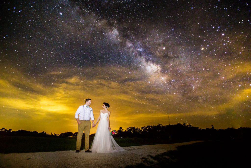 Steven Miller Photography - bride and groom with Milky Way night sky in background