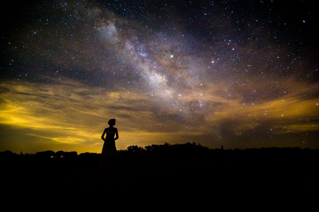 Steven Miller Photography - Bride silhouetted against night sky with Milky Way