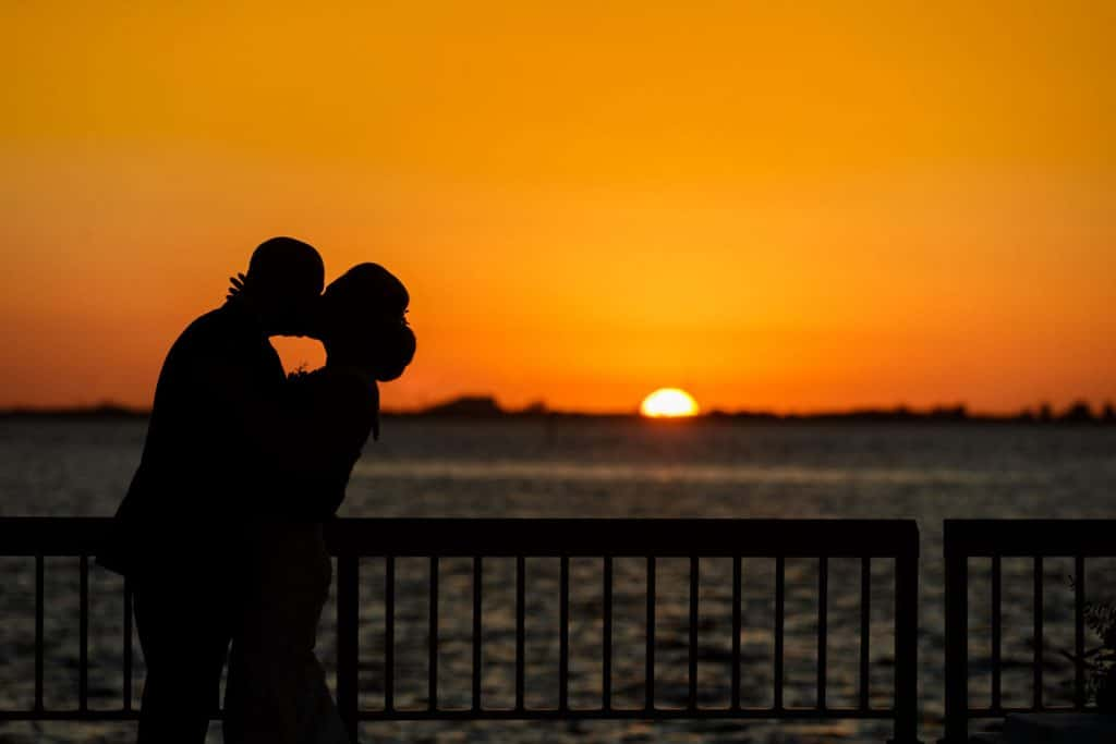 Steven Miller Photography - silhouette of bride and groom at sunset