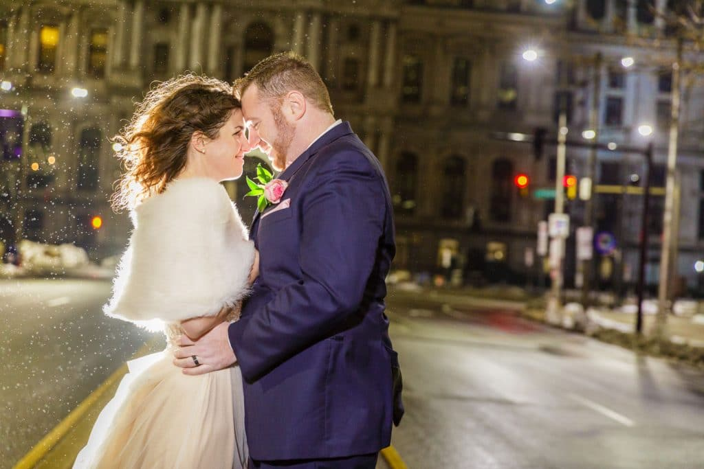 Steven Miller Photography - bride and groom on snowy street