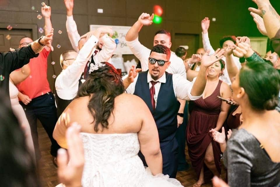 DJ Danny Garcia- groom glasses on groom while dancing with bride and guest around them
