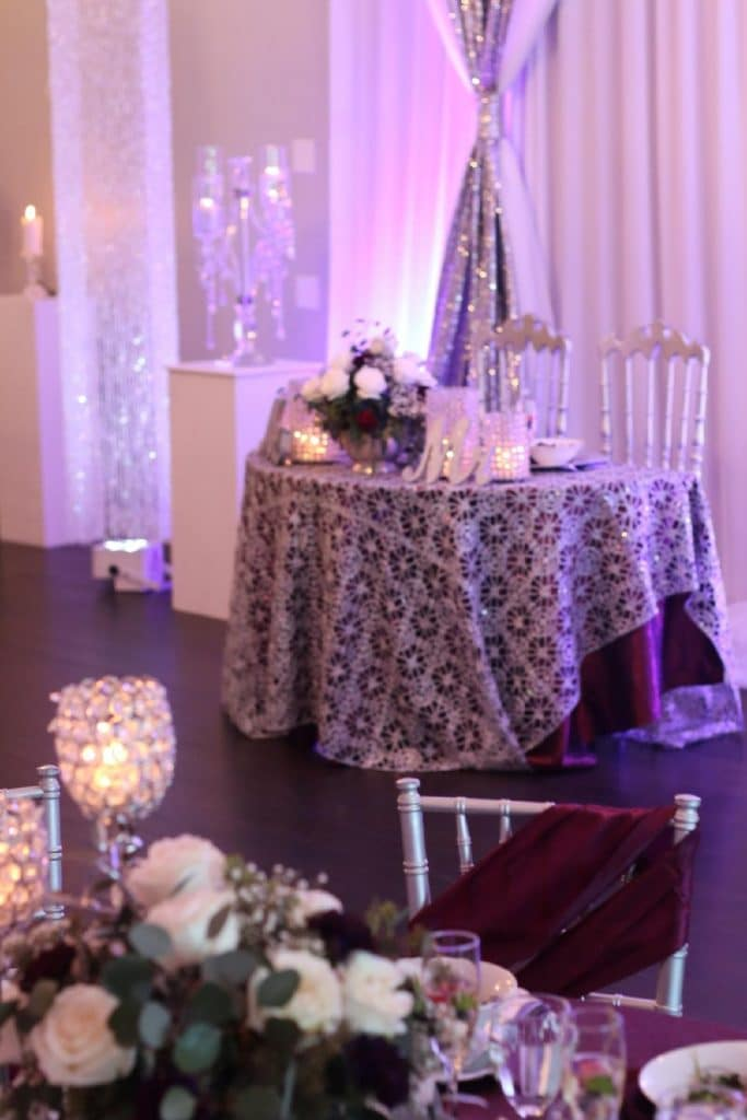 Destiny Event Venue - sweetheart table with purple tablecloth and lace overlay