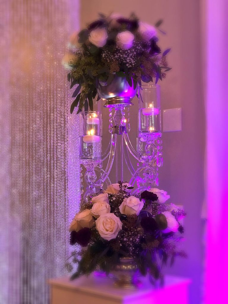 Destiny Event Venue - tall floral arrangements with floating candles