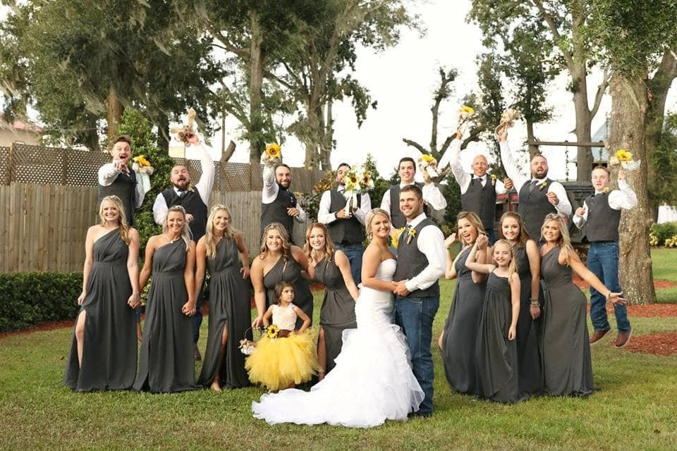 Harmony-Haven-Events-Full bridal party silly and fun faces with sunflowers