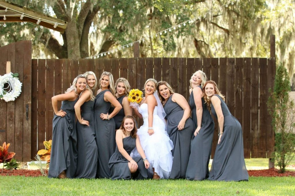Harmony-Haven-Events-Fun bridesmaids posing with bride outdoors