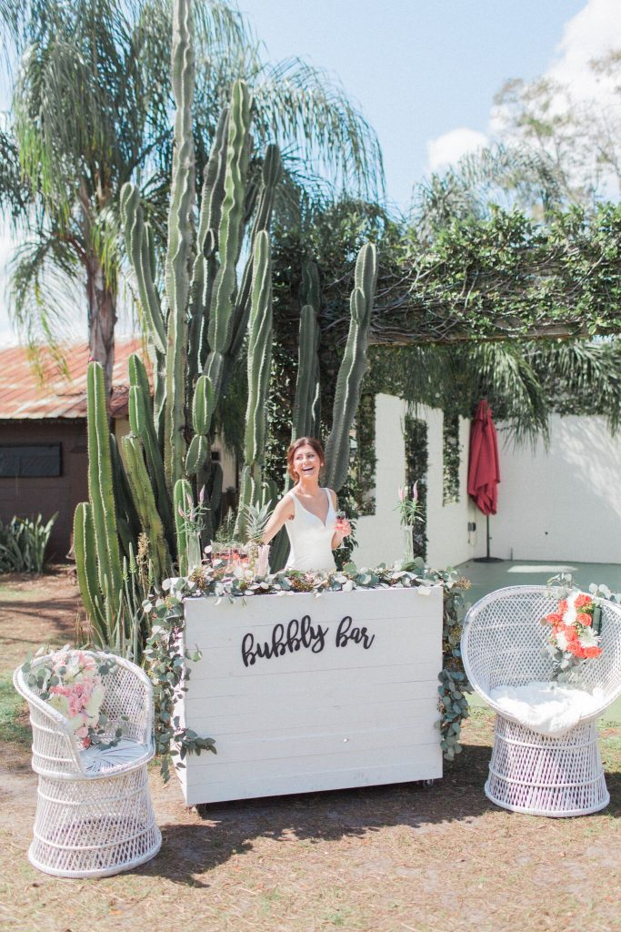 "Orlando Wedding & Party Rentals - bride behind the ""bubbly bar"""