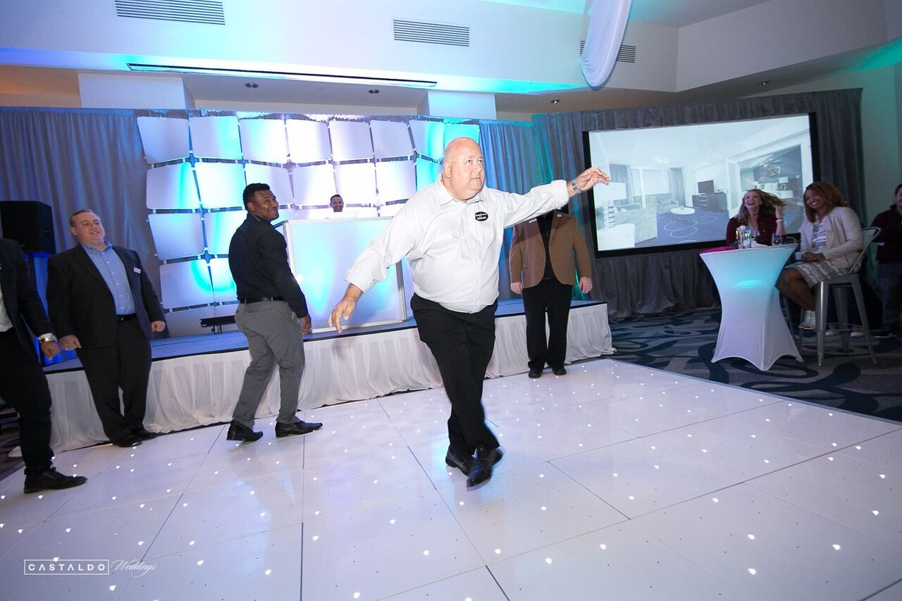 Orlando Wedding & Party Rentals - large white dance floor sets the tone for an event
