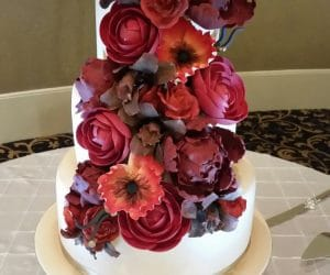 The Cake Studio - wedding cake with large cascade of flowers