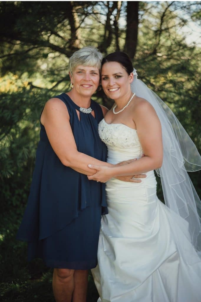 TrueHeart-Ranch- Bride standing with mother of bride outdoors