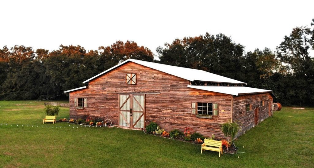 TrueHeart-Ranch- Corner view of the barn venue with shrubbery
