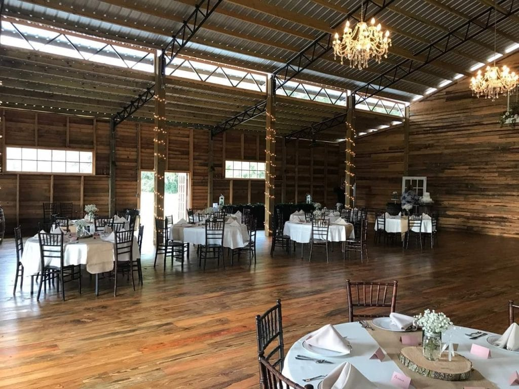 TrueHeart-Ranch- Inside the barn venue with tables set up for reception