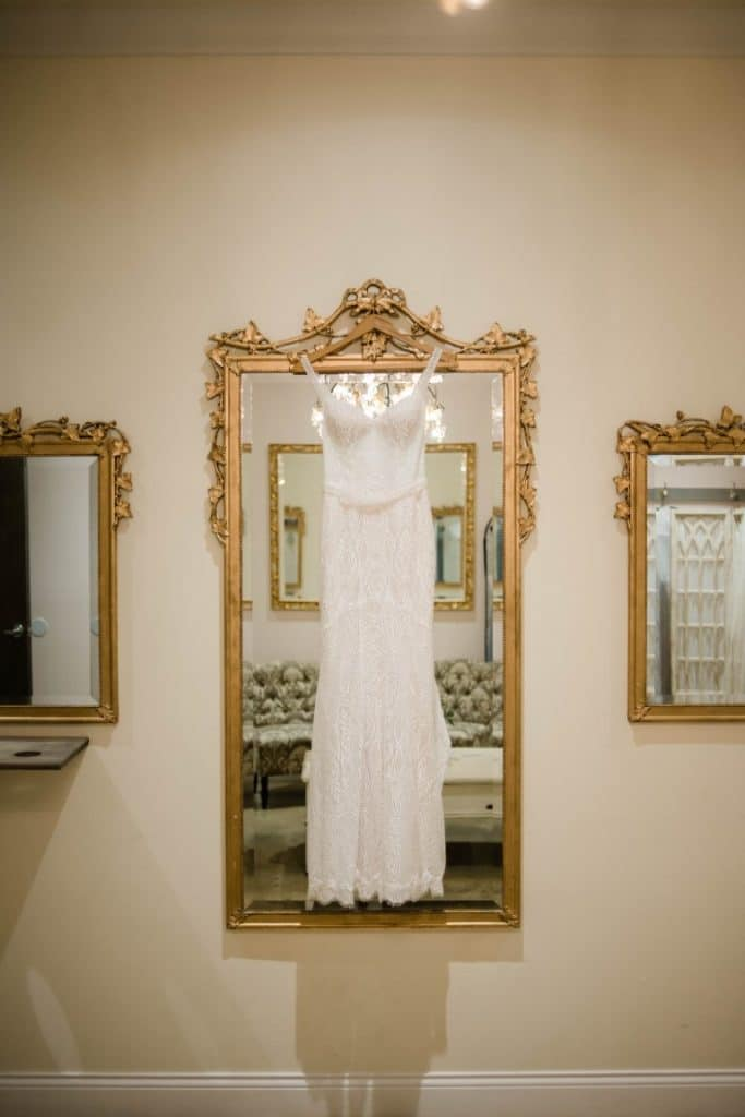 Venue-650-Wedding dress hanging over full length framed mirror