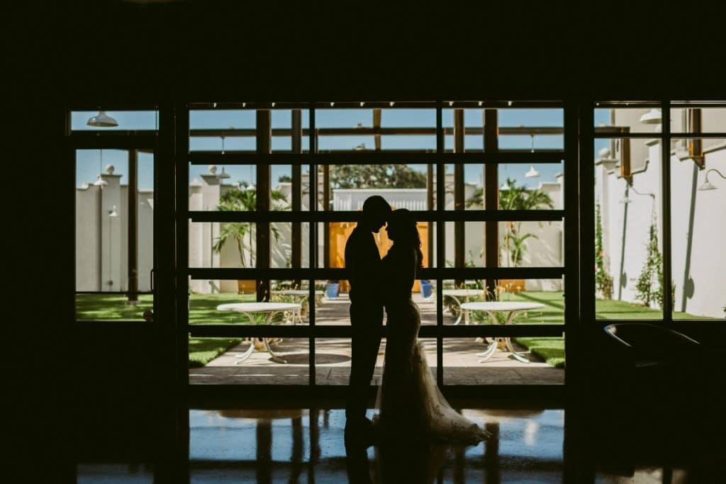 Venue-650-Silhouette of couple kissing by courtyard
