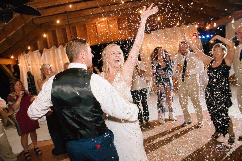 Bride and groom dancing with confetti