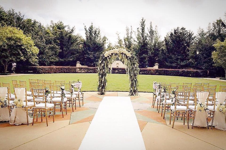 Atmospheres Floral and Decor - floral draped arch at wedding ceremony