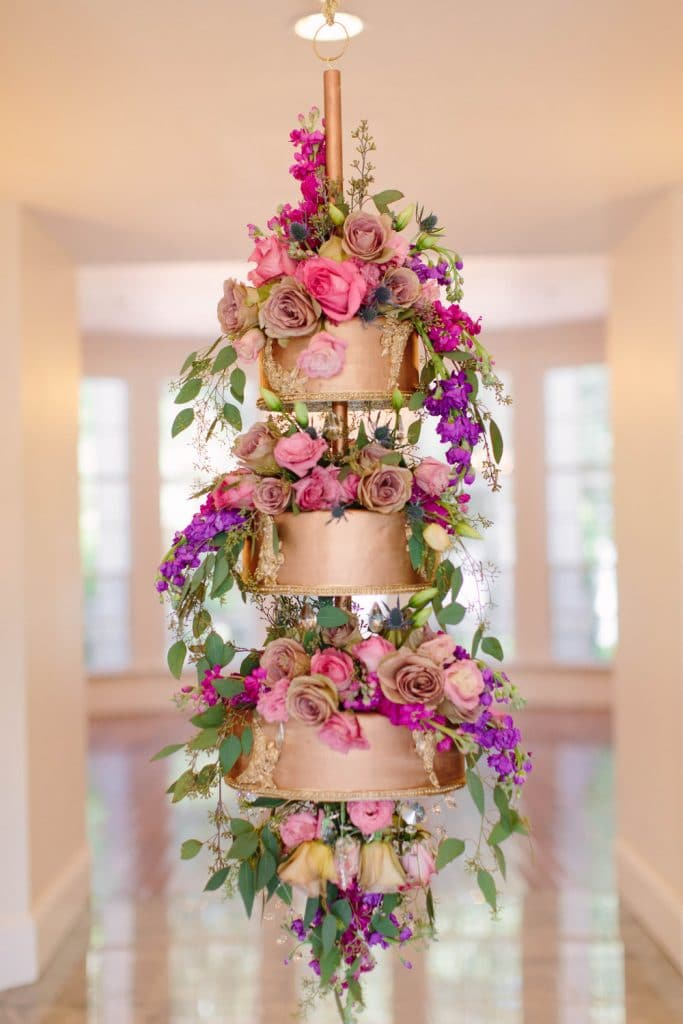 Atmospheres Floral and Decor - pink and purple flowers in hanging tiered rose gold container