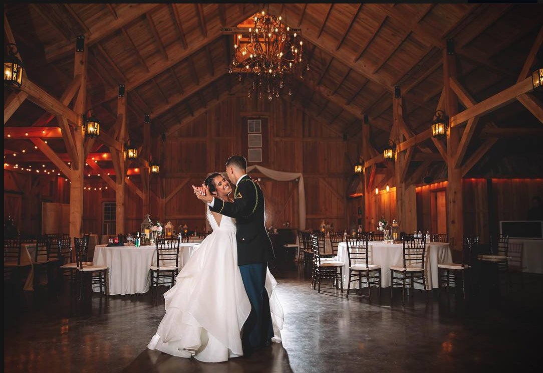 Bridle Oaks Barn - couple dancing in barn wedding venue with all-wood interior