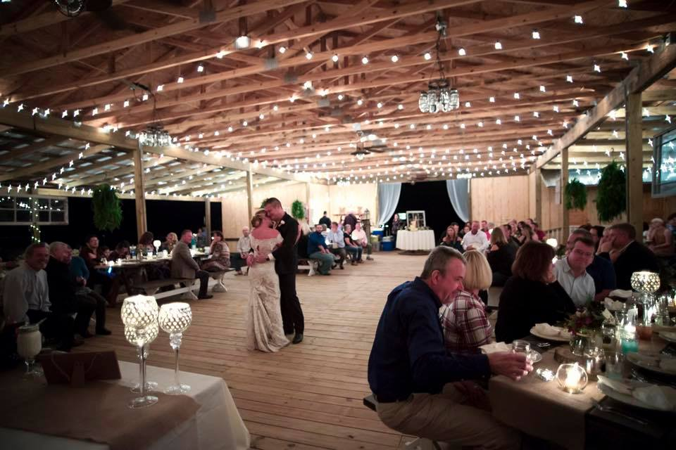 Bridlewood Ranch - open barn space strung with market lighting