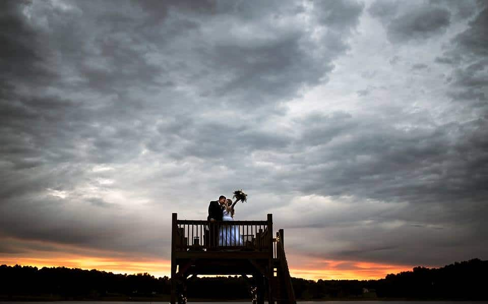 Bridlewood Farms - couple on top of tall wooden stand