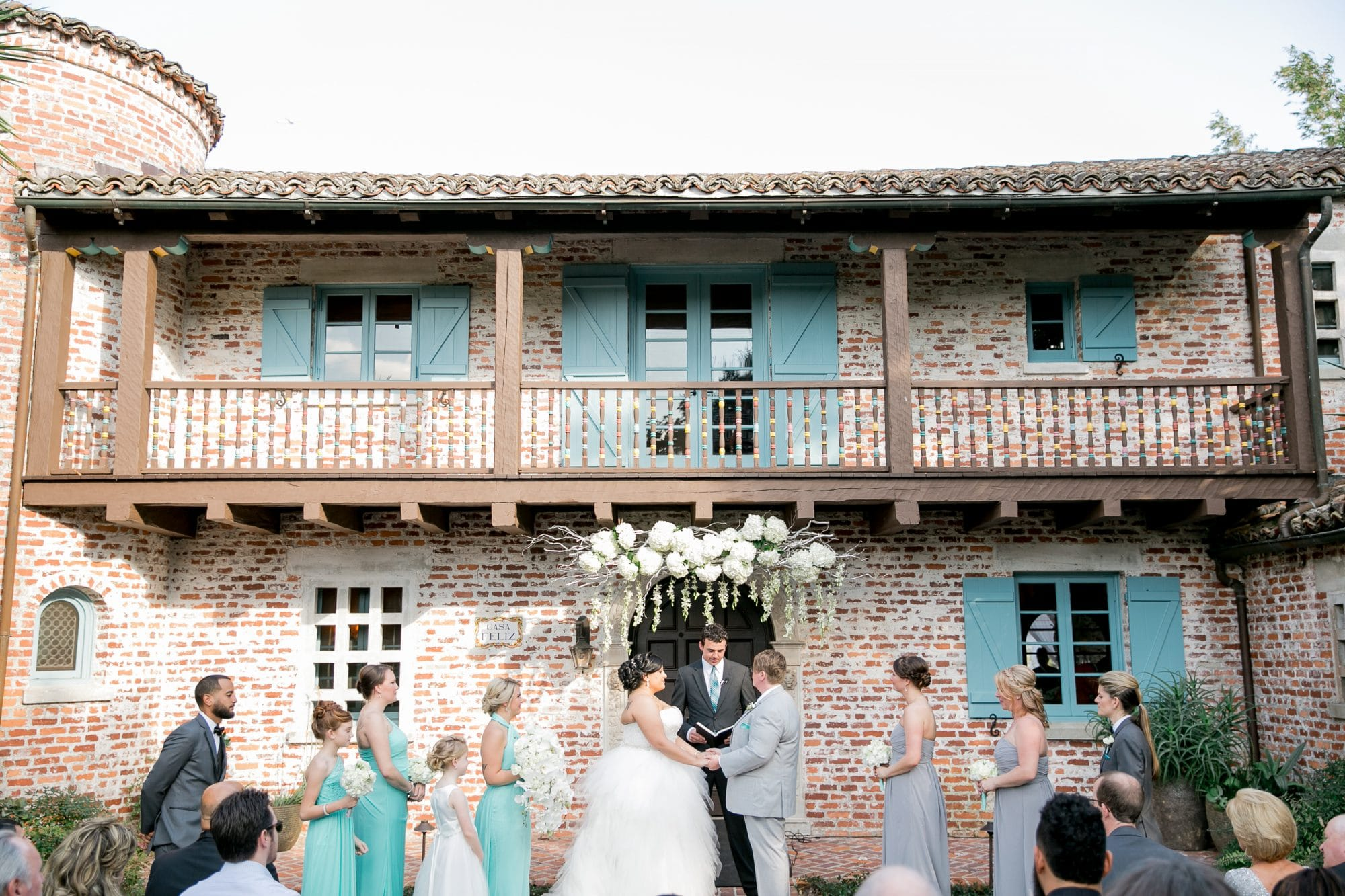 Casa Feliz - wedding ceremony in front of old brick building