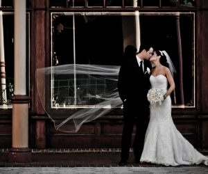 Chris Gillyard Photography - bride and groom in front of vintage storefront