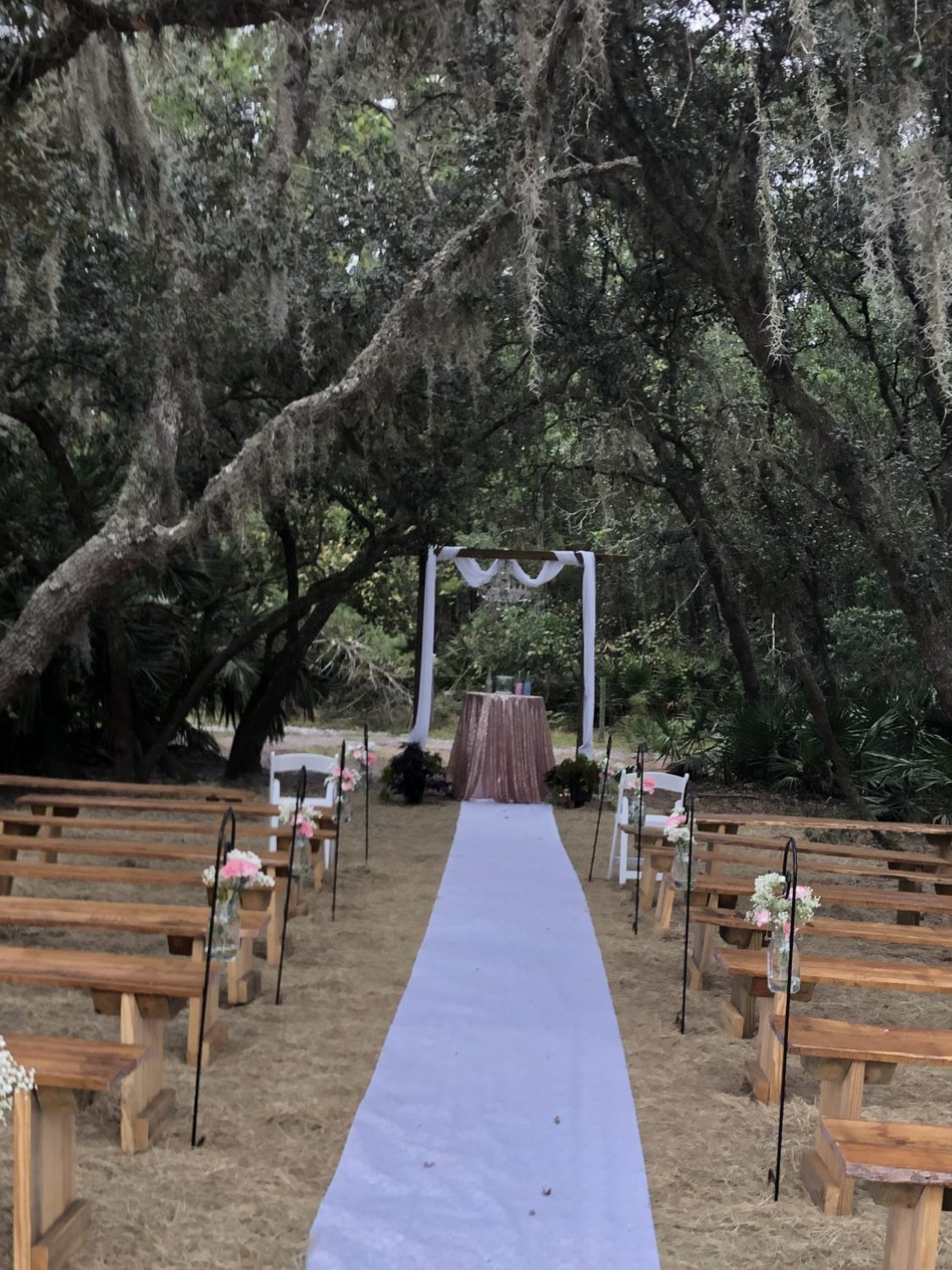 Diamond L Venue - outdoor ceremony location with rustic bench seating