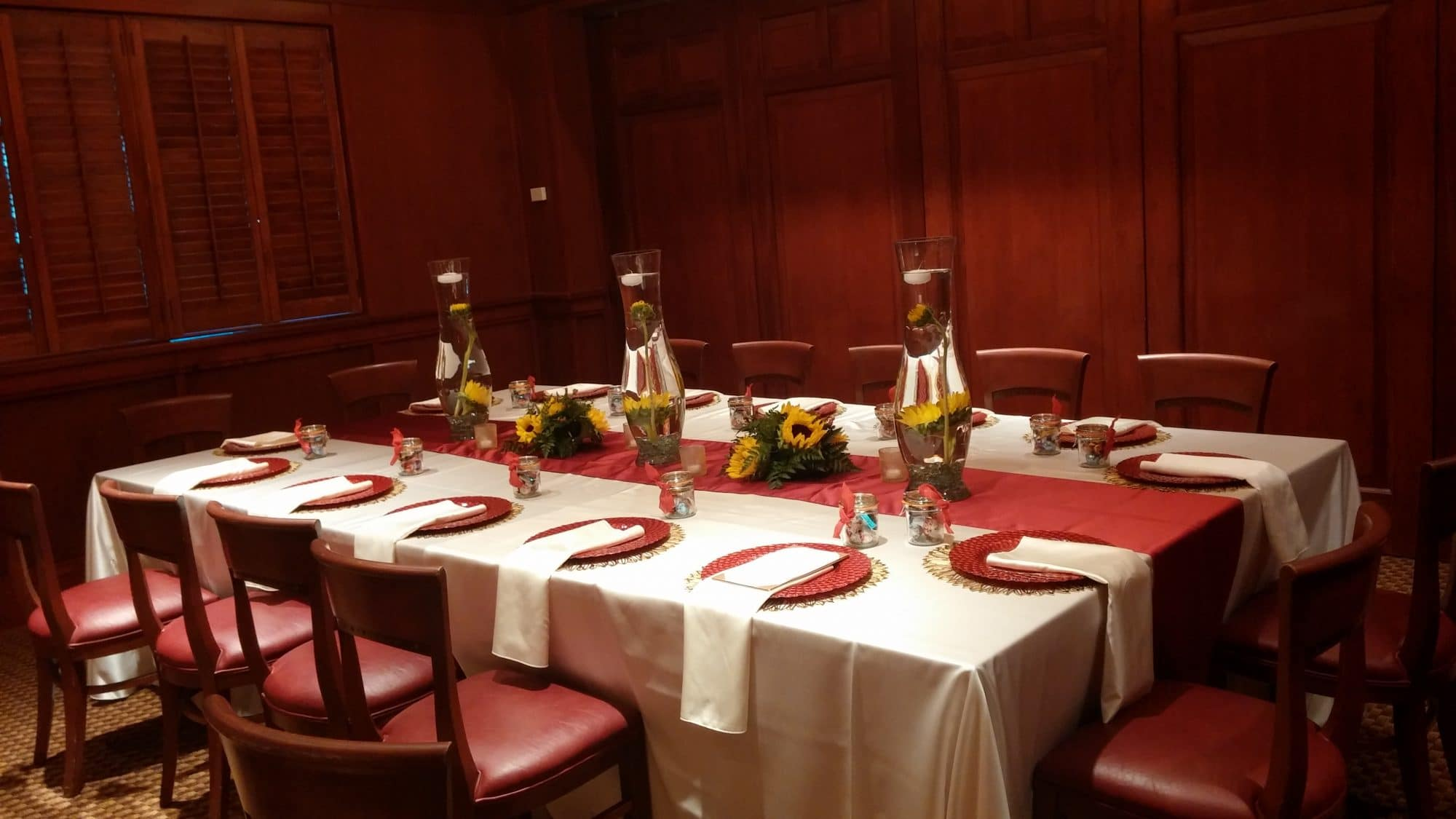 Fleming's Winter Park - reception table set up with sunflowers in wood-paneled room