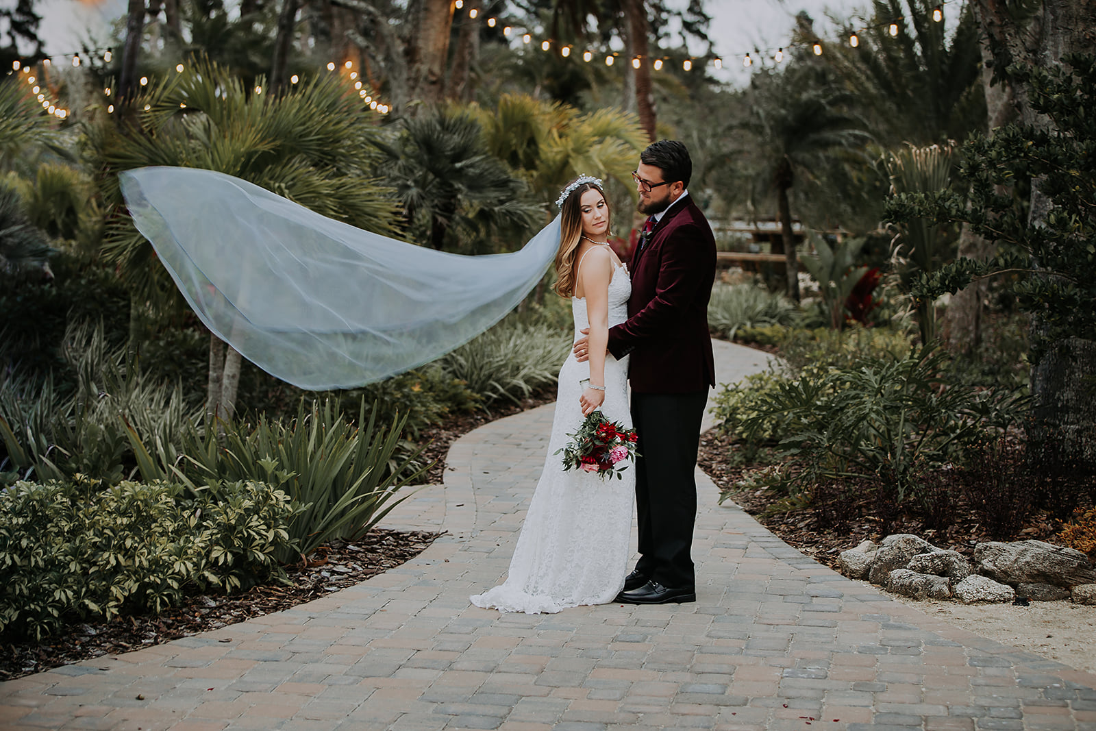Grant Station Events - newlyweds in lush setting on paved stone path