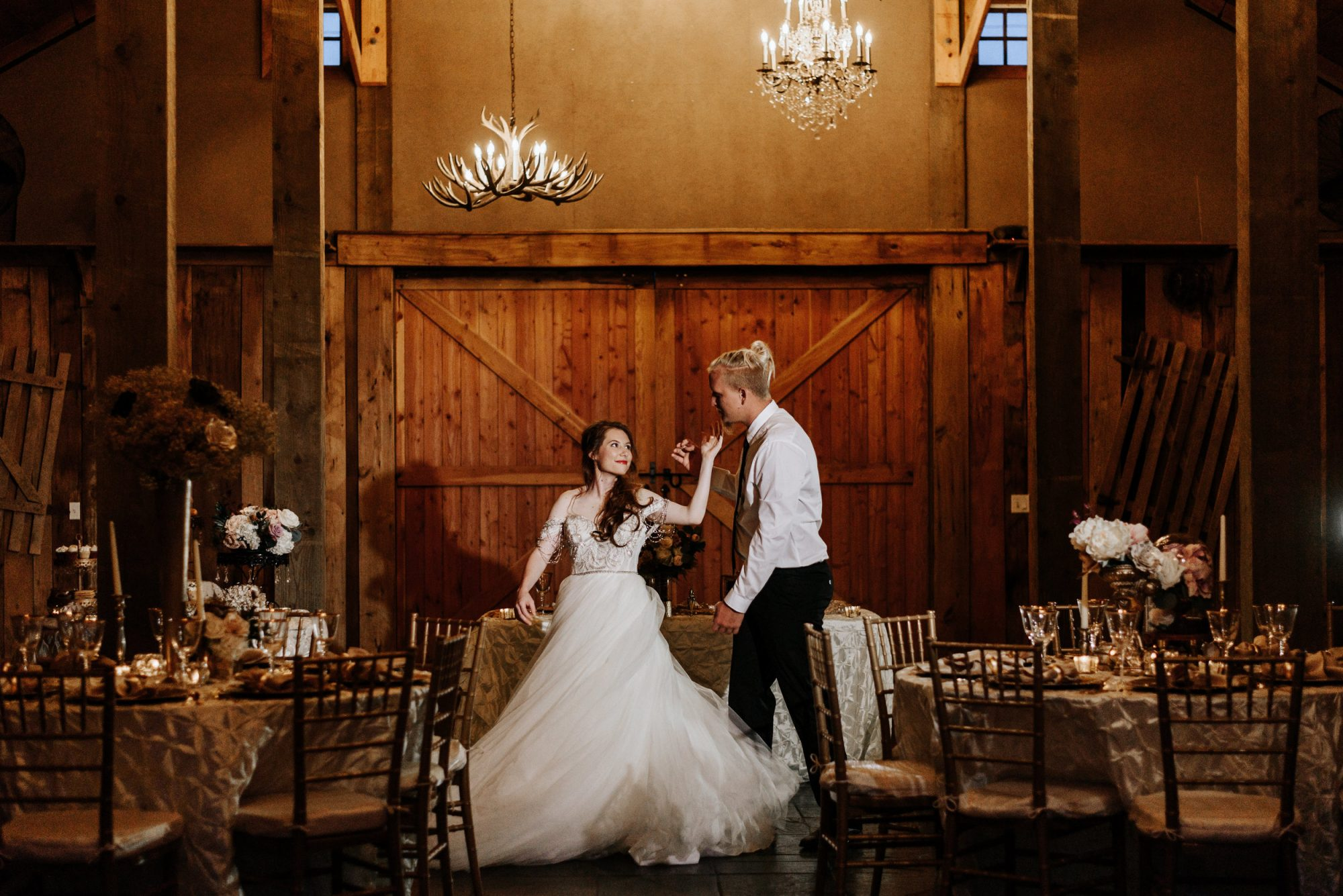 Grant Station Events - bride and groom dancing under chandeliers in rustic barn