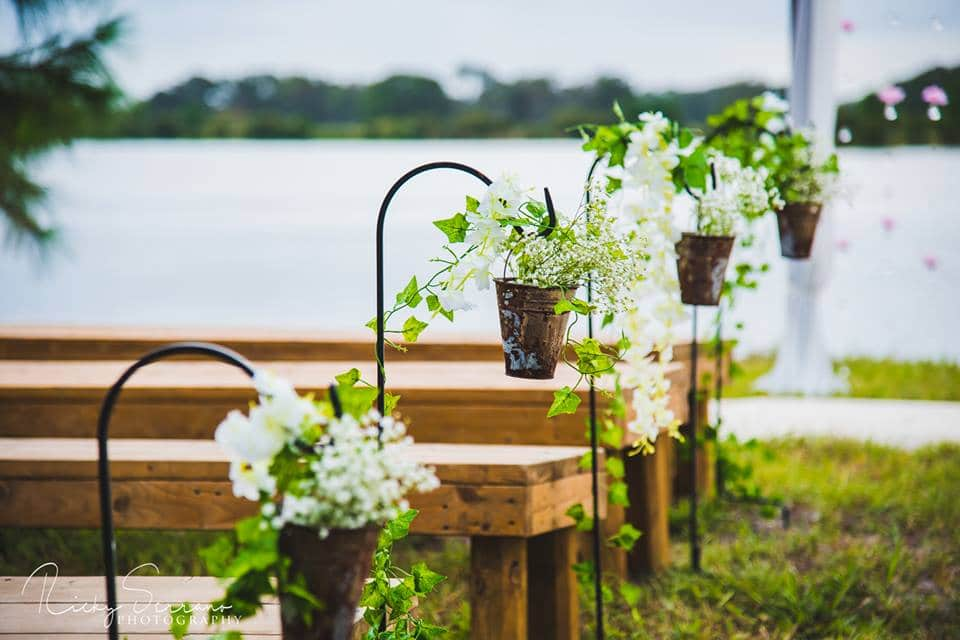 Hastings Ranch & Farm - ceremony benches with ivy in buckets